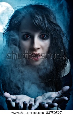 Shot of Vampire Girl in the moonlight and mist - stock photo