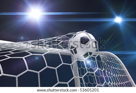 Shot on goal, soccer ball in the net - stock photo