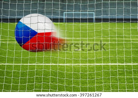 Shot on goal, soccer ball with the flag of Czech republic in the net  - stock photo