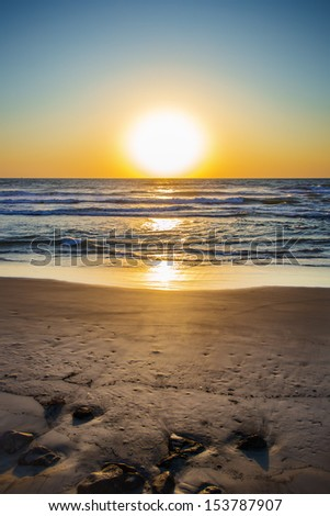 shot was taken when the sun have not quite went away so the waves were unusual shine - stock photo