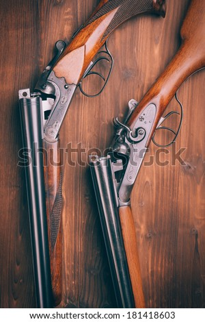 Shotgun on wooden background - stock photo