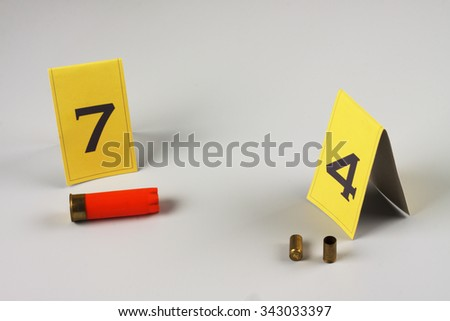 shotgun shell marked as evidence on grey - stock photo