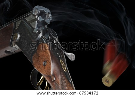 Shotgun with cartridges on a black background - stock photo