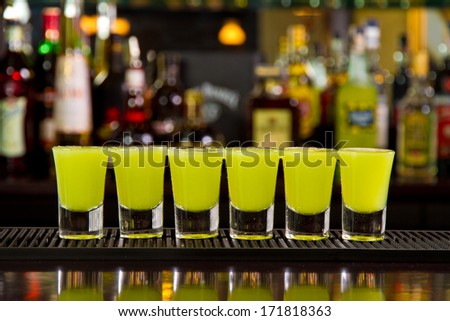 Shots on a bar counter top - stock photo