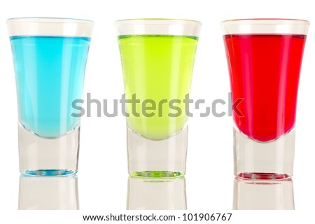 Shots - Three colourful shot drinks on a white background with reflections - stock photo