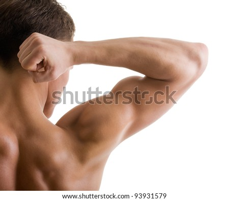 shoulder and arm naked male body (an athlete) - stock photo