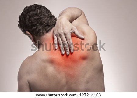 Shoulder and back pain isolated injury concept - stock photo