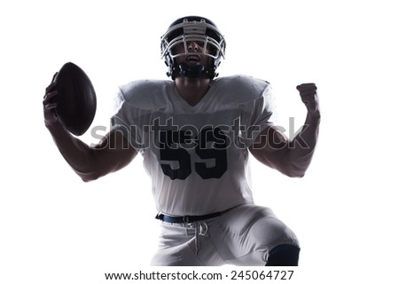 Shout of joy.  American football player screaming and standing on knee against white background  - stock photo