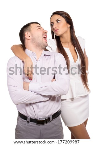 Shout one another. Yelling at each other. Family portrait of a modern young people. Unusual love story. Complex family relationships. Woman dominates man. Love and hate each other simultaneously. - stock photo