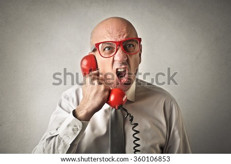 Shouting on the phone - stock photo