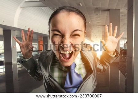 Shouting woman in the office - stock photo