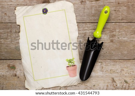 Shovel for horticulture and image on a wooden background - stock photo