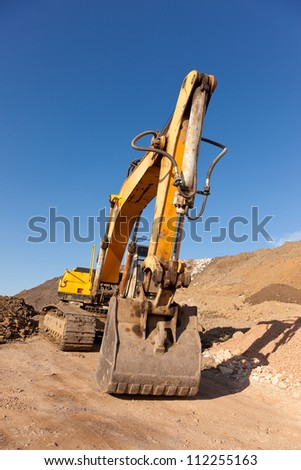 Shovel of yellow excavation machine - stock photo