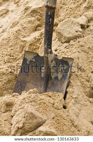Shovel on sand. - stock photo