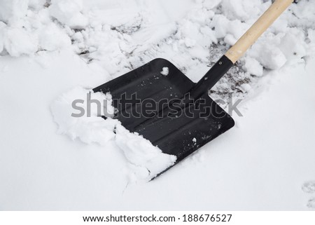 shovel to clean snow - stock photo