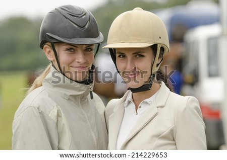 show jumping riders - stock photo