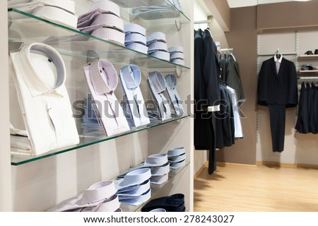 Show window in men's boutique of classical clothes - stock photo
