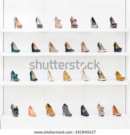 Showcase with female shoes placing in a row in the modern shopping center - stock photo