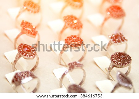Showcase with rings of small black stones - stock photo