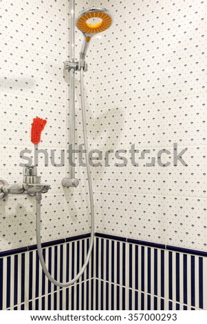 Shower cabin with a stand with a shower and tap water - stock photo