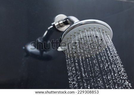 shower head in bathroom with water drops flowing - stock photo