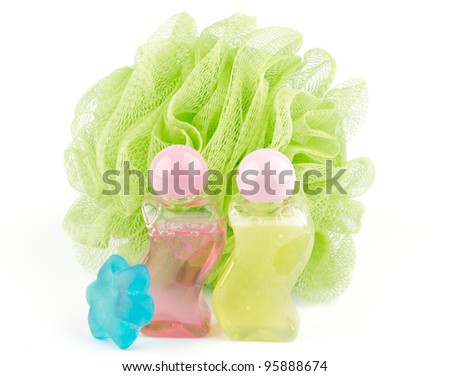 Shower Puff, shower gel and decorative soap isolated on white background - stock photo