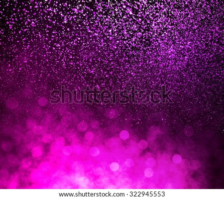 shower purple water drops on black background - stock photo