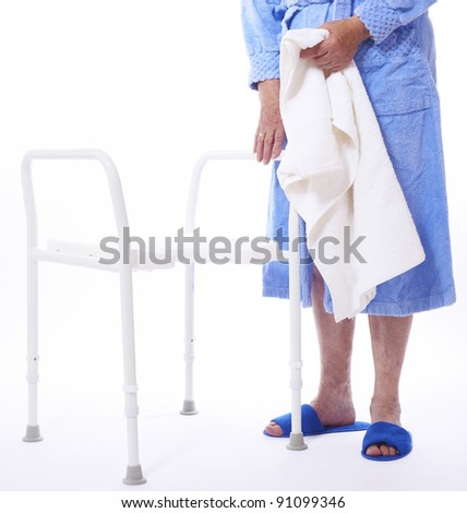 Shower seat and elderly woman - stock photo