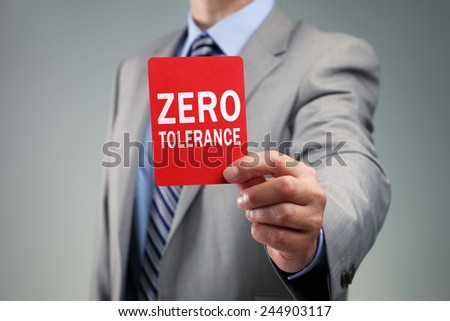 Showing a zero tolerance red card concept for bad business practice, exclusion or criminal activity - stock photo