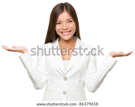 Showing business woman with open hand palms for copy space for two products. Businesswoman in white suit isolated on white background. Happy smiling multiracial Chinese Asian / Caucasian female model. - stock photo