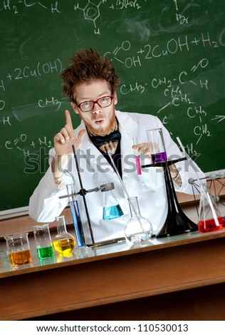 Showing forefinger mad professor is in his laboratory - stock photo