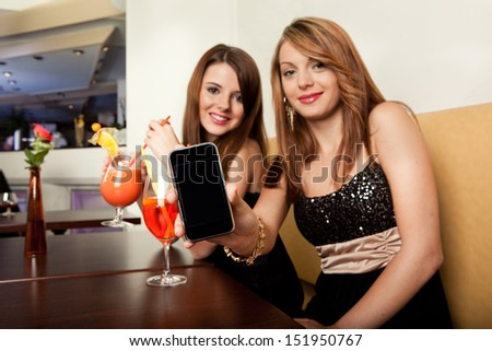 Showing mobile phone with blank screen. Focus on the phone - stock photo