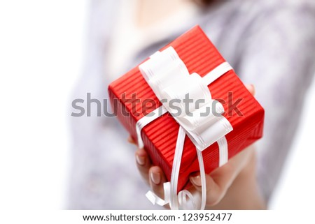 Showing present wrapped in red gift paper, isolated on white - stock photo