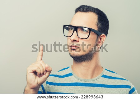 showing with index finger number one - stock photo