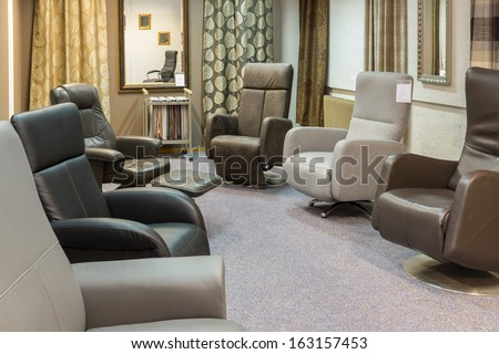 Showroom of modern furniture store with luxury armchairs - stock photo