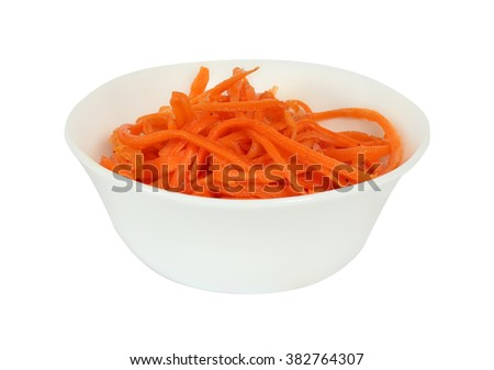 Shredded carrots (Korean) with spices and oil. Isolation on a white background. Clipping path. - stock photo