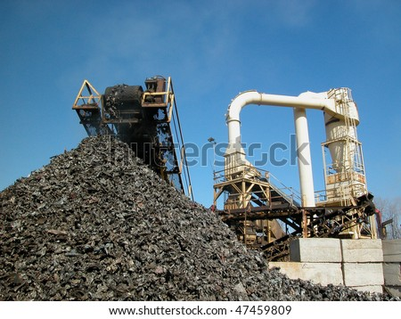 shredded cars being processed for recycling - stock photo