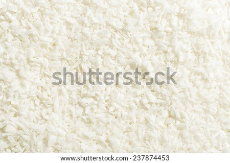 Shredded coconut shavings abstract texture background - stock photo