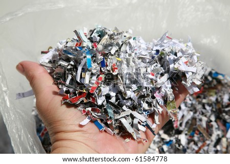 Shredded paper, shredded checks, credit cards and other sensitive information and more to prevent identity theft - stock photo