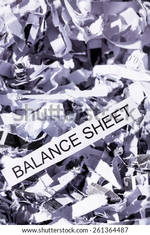 shredded paper tagged with balance sheet, symbolic photo for data destruction, budgets and accounting - stock photo
