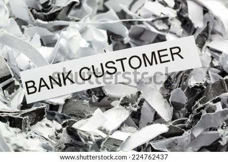 shredded paper tagged with bank customer, symbol photo for data destruction, customer data and bank secrecy - stock photo