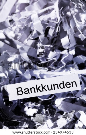 shredded paper tagged with bank customers, symbolic photo for data destruction, customer data and bank secrecy - stock photo