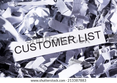 shredded paper tagged with customer list, symbol photo for data destruction, data protection and customer data - stock photo