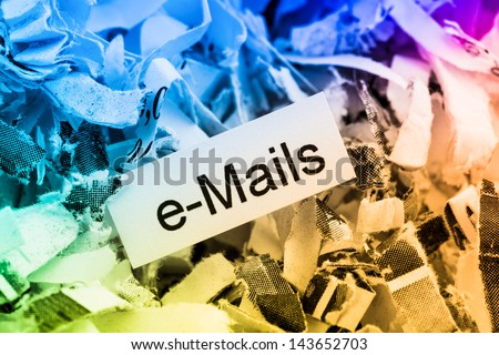 shredded paper tagged with e-mails, symbolic photo for data destruction, e-mails and data flooding - stock photo