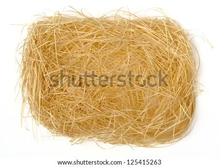 shredded paper texture in bird nest shape - stock photo