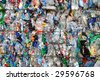 Shreddered plastic bottle on a recycling site - stock photo