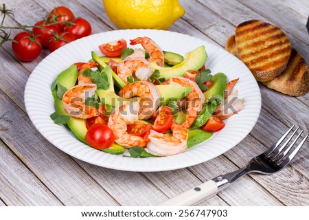 Shrimp and avocado salad - stock photo