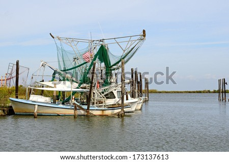 Shrimp and fishing boats at port in the swamp land near New Orleans in Louisiana - stock photo