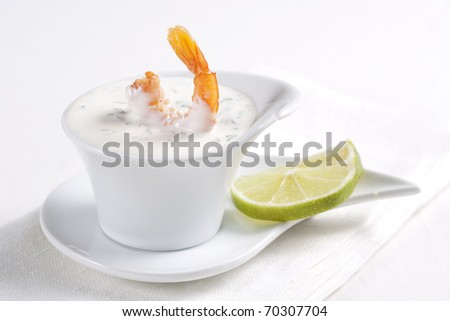 Shrimp dipped in sauce and lime - stock photo