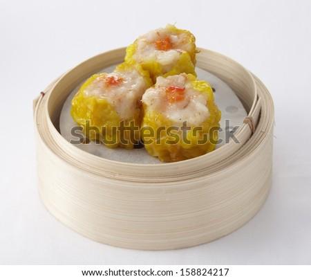 Shrimp dumplings in a bamboo steamer - stock photo